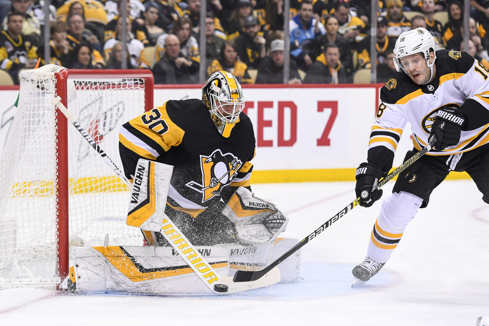 PITTSBURGH, PA - MARCH 10: Pittsburgh Penguins Goalie Matt Murray (30) makes a save with Boston Bruins Right Wing Lee Stempniak (18) in front during the first period in the NHL game between the Pittsburgh Penguins and the Boston Bruins on March 10, 2019, at PPG Paints Arena in Pittsburgh, PA. (Photo by Jeanine Leech/Icon Sportswire)