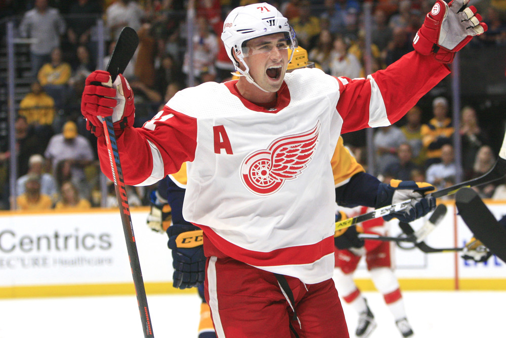 NASHVILLE, TN - OCTOBER 05: Detroit Red Wings center Dylan Larkin (71) celebrates a Detroit goal during the NHL game between the Nashville Predators and Detroit Red Wings, held on October 5, 2019, at Bridgestone Arena in Nashville, Tennessee. (Photo by Danny Murphy/Icon Sportswire)